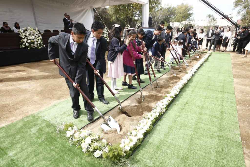 Latter-day Saint children lift a shovel-full of dirt at the groundbreaking of the Puebla Mexico Temple on Saturday, Nov. 30, 2019.