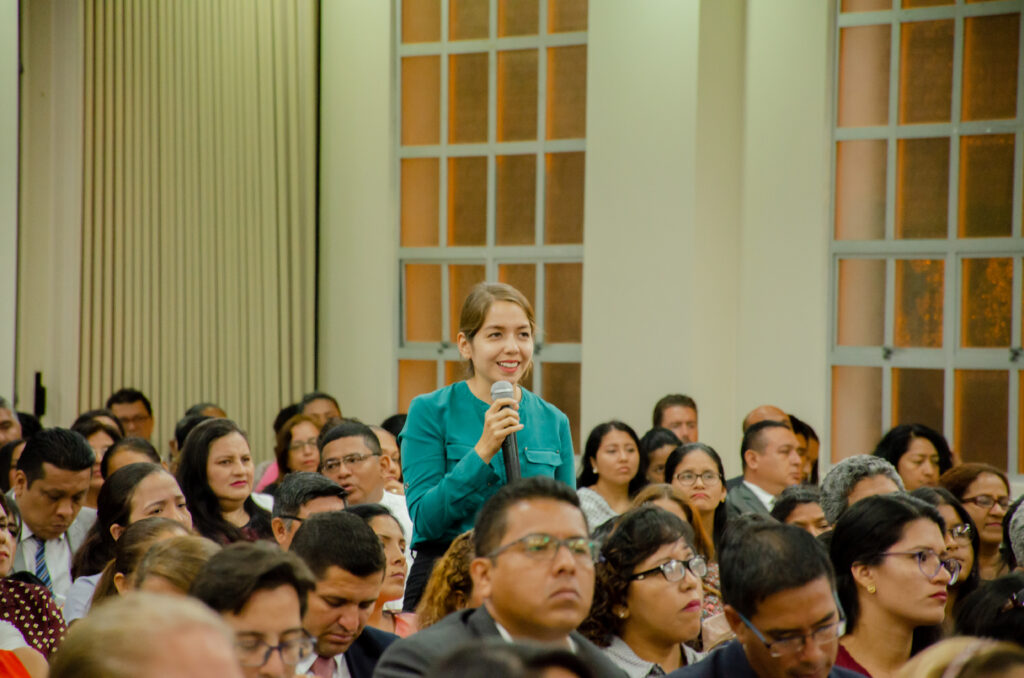 Latter-day Saints ask questions during a leadership meeting with Sister Reyna I. Aburto in Guayaquil, Ecuador, during her visit to the South America Northwest Area of the Church in November 2019.