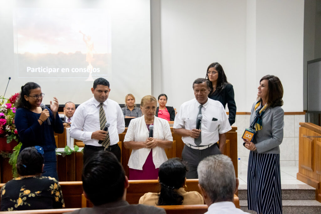 Sister Lisa L. Harkness, right, does a training exercise with Church members at a leadership meeting in Guayaquil, Ecuador, during a visit to the South America Northwest Area of the Church in November 2019.