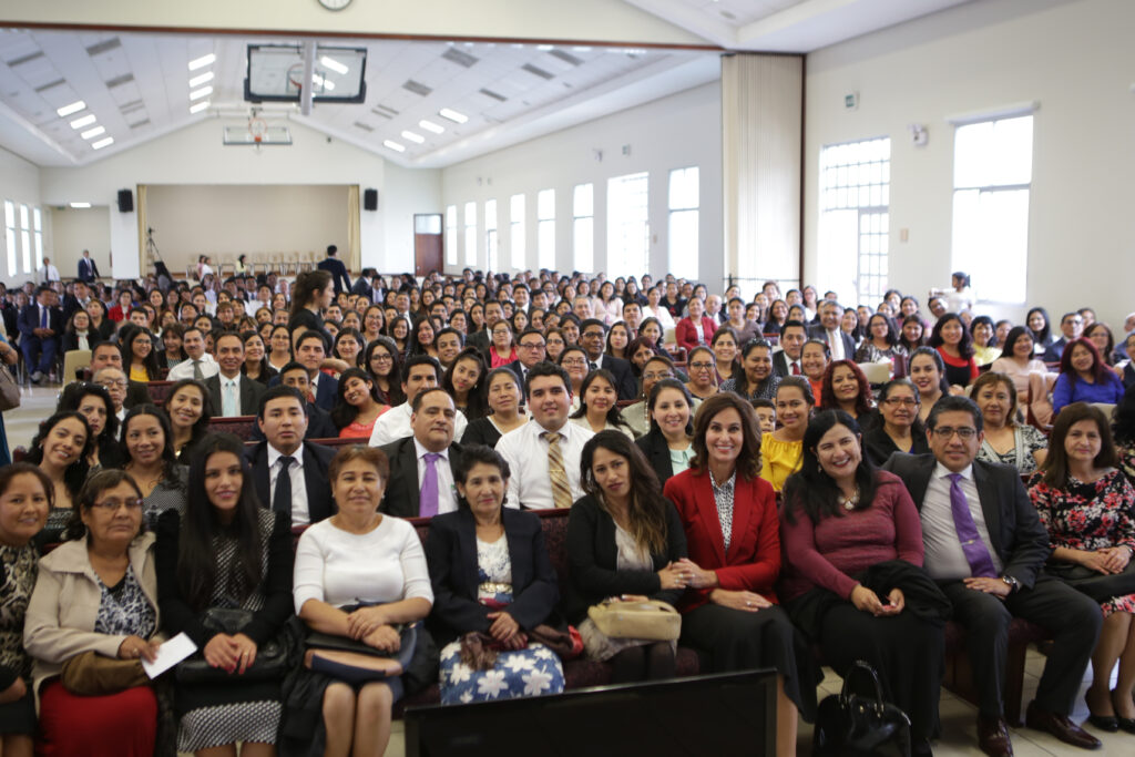 Sister Lisa L. Harkness, center, sits for a photo with members of the church in Lima, Peru, after a leadership meeting during a visit to the South America Northwest Area of the Church in November 2019.