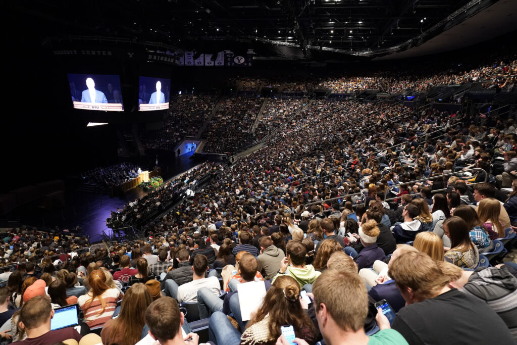 Students listen to Elder Dale G. Renlund of the Quorum of the Twelve Apostles speaks during the BYU campus devotional in the Marriott Center in Provo, Utah, on Dec. 3, 2019.