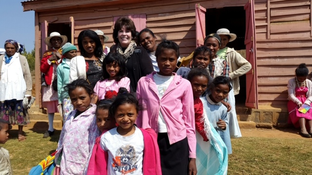 Sister Michele Rossiter surrounded by children in Madagascar. She served a medical senior mission from 2014 to 2016.