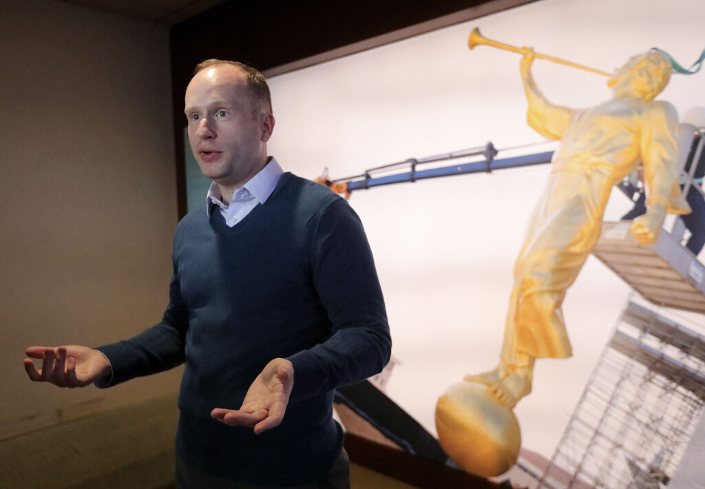 Tanner Kay, Temple Square guest experience manager, talks about upcoming changes for visitors to Temple Square when the Salt Lake Temple closes for renovations, at the Temple Square South Visitors Center in Salt Lake City on Wednesday, Dec. 4, 2019.