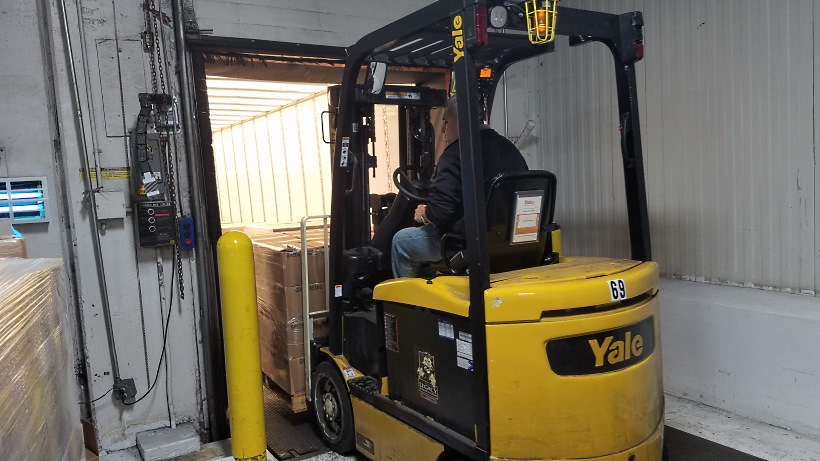 A Houston Food Bank forklift unloads a pallet of food donated by the Church on Nov. 6, 2019.