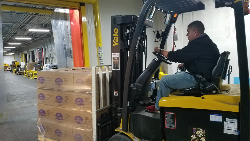 A forklift moves Church donated food at the Houston Food Bank on Nov. 6, 2019.