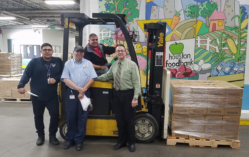 Steve Stotts, the Church Welfare and Self-Reliance manager for the Houston area, at right, helps deliver 40,000 pounds of food to the Houston Food Bank on Nov. 6, 2019.
