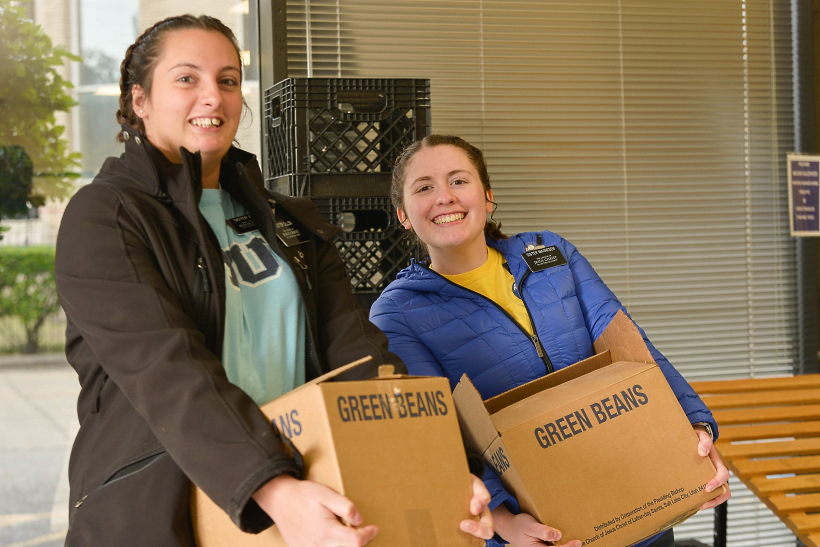 Sister missionaries help restock shelves at Northwest Assistance Ministries in Houston, Texas, with donations from the Church on Nov. 13, 2019.