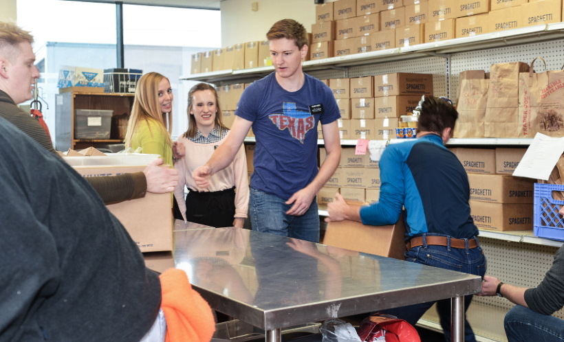 Young missionaries help restock shelves atNorthwest Assistance Ministries in Houston, Texas, with donations from the Church Welfare Department onNov. 13, 2019.