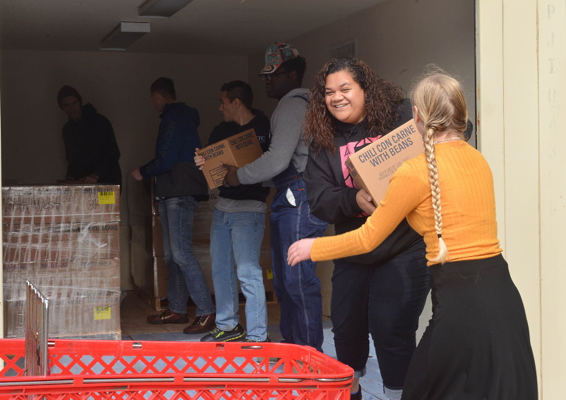 Young missionaries in Houston, Texas, help unload a truck of food for local food pantries on Nov. 13, 2019.