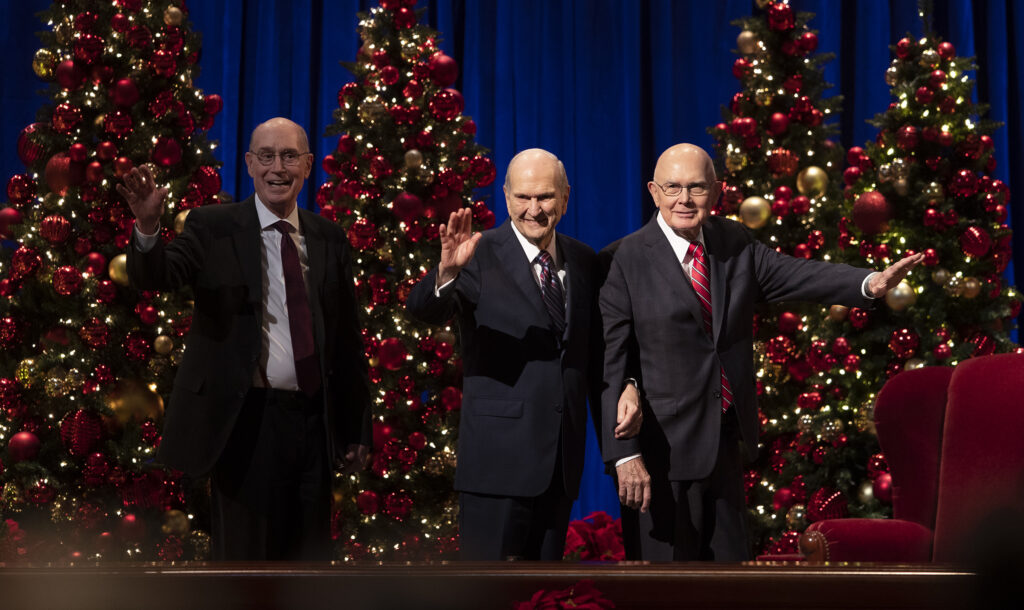 President Henry B. Eyring, President Russell M. Nelson and President Dallin H. Oaks of the First Presidency of The Church of Jesus Christ of Latter-day Saints, wave to the crowd as they exit the stand following the Christmas devotional at the Conference Center in Salt Lake City on Sunday, Dec. 8, 2019.