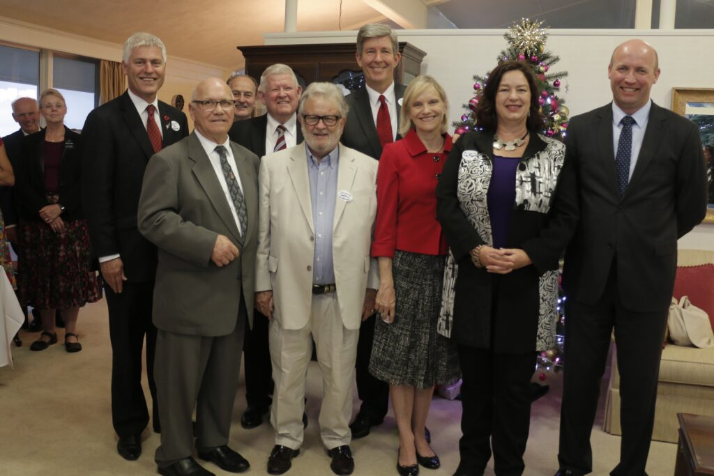 Elder S. Gifford Nielsen and his wife, Sister Wendy Nielsen, fourth and third from the right, join Tim Macindoe MP, left back, and other hosts and guest at the Hamilton New Zealand Temple Christmas Lights in December 2015.