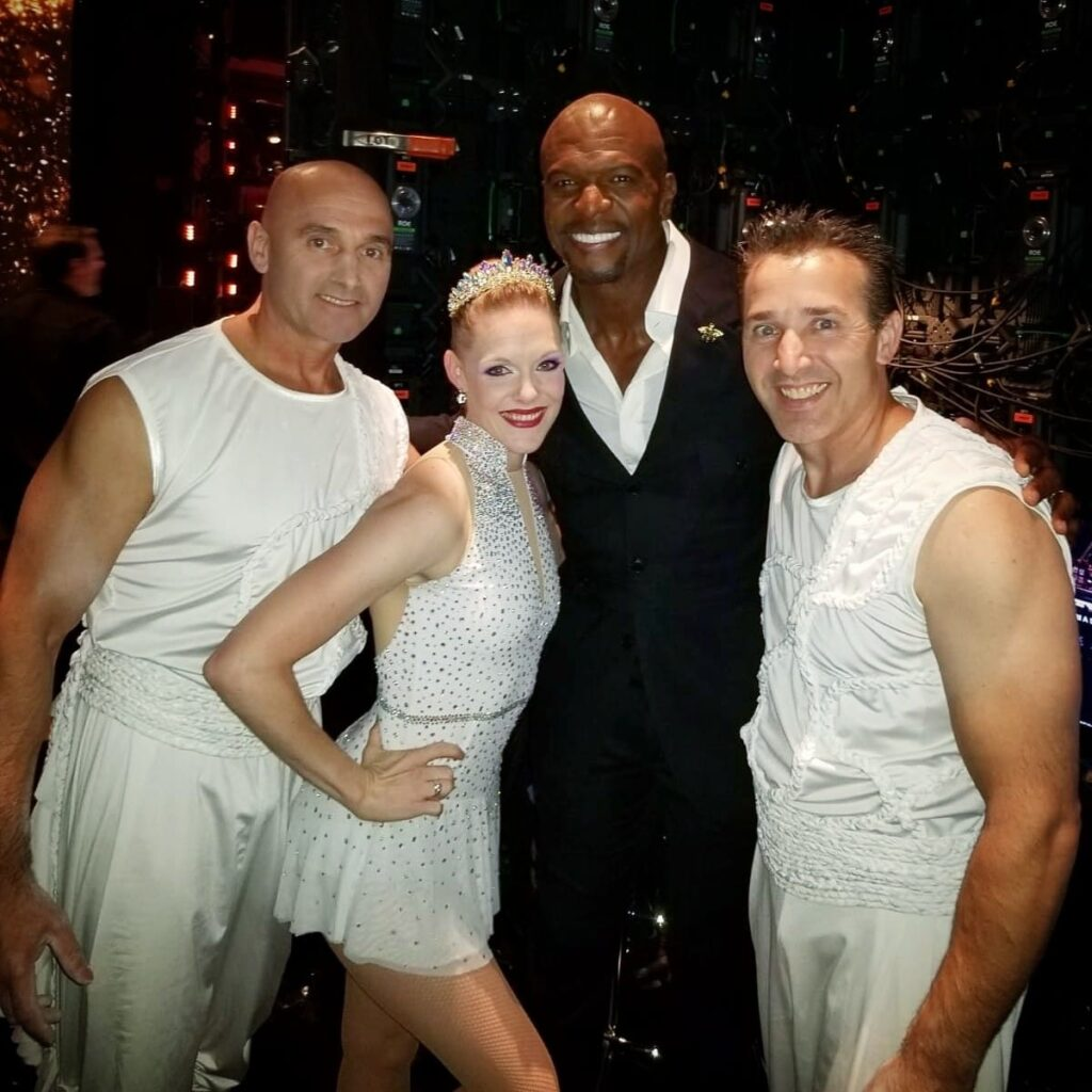 """From left, Sergei Sandou, Cassie Sandou and Konstantin Sandou are pictured with Terry Crews, middle right, at the Dolby Theatre in Los Angeles on Aug. 28, 2019. The Sandou Trio performed for the live results of """"America's Got Talent"""" season 14 and will be featured on the second season of """"America's Got Talent: Champions"""" airing in January."""