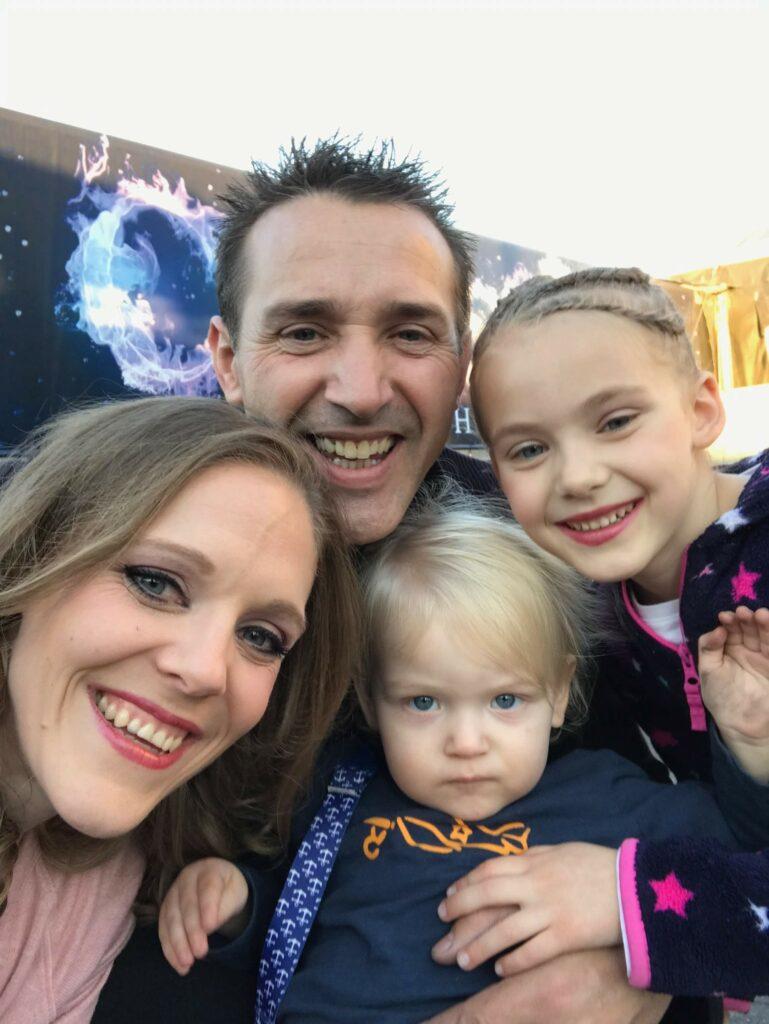 The Sandou family smiles for a selfie in November 2019.