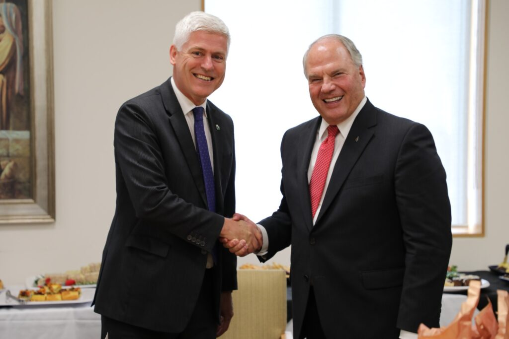 Elder Ronald A. Rasband, right, greets Tim Macindoe, MP of West Hamilton in a Nov. 16, 2019, meeting in Hamilton, New Zealand.