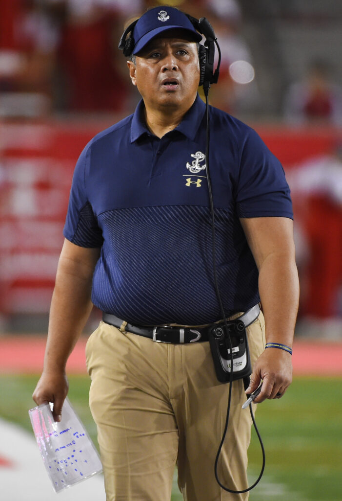 Navy head coach Ken Niumatalolo walks the sideline during the first half of an NCAA college football game against Houston, Saturday, Nov. 30, 2019, in Houston.