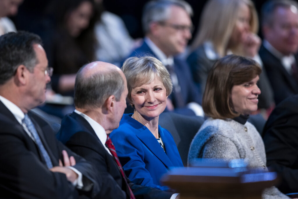 Sister Jean B. Bingham with her husband, Bruce Bingham, on the stand prior to a BYU campus devotional in the Marriott Center in Provo, Utah on Dec. 10, 2019.