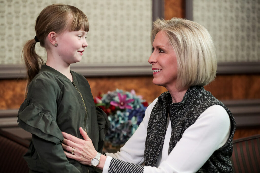 Jane Hellewell, 8, of Provo, Utah, talks with Primary general president Sister Joy D. Jones, of The Church of Jesus Christ of Latter-day Saints, after a screening of the Book of Mormon Videos in the Joseph Smith Memorial Building Legacy Theater in Salt Lake City on Saturday, Dec. 7, 2019.
