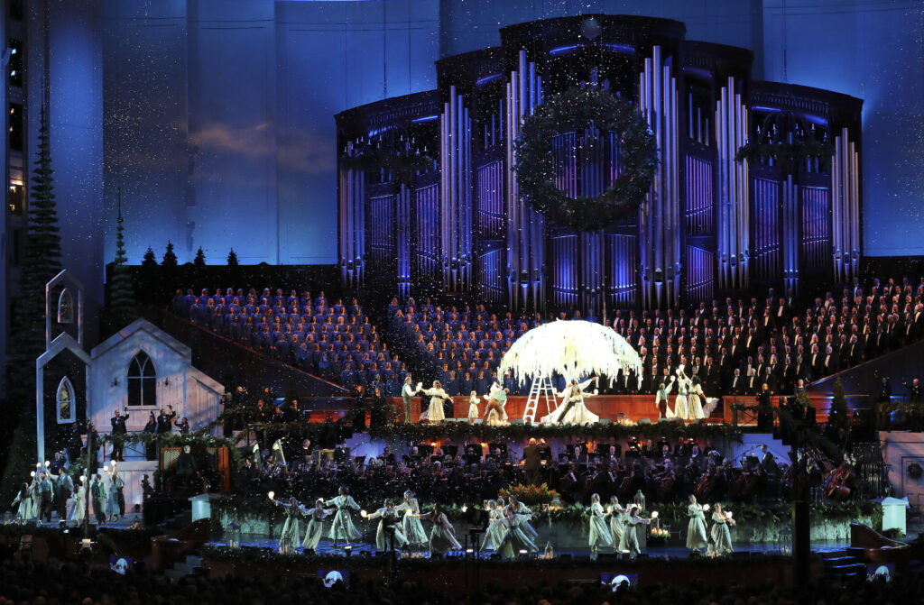 Dancers perform with the Tabernacle Choir at Temple Square and Orchestra at Temple Square during a Christmas concert at the Conference Center in Salt Lake City on Thursday, Dec. 12, 2019.