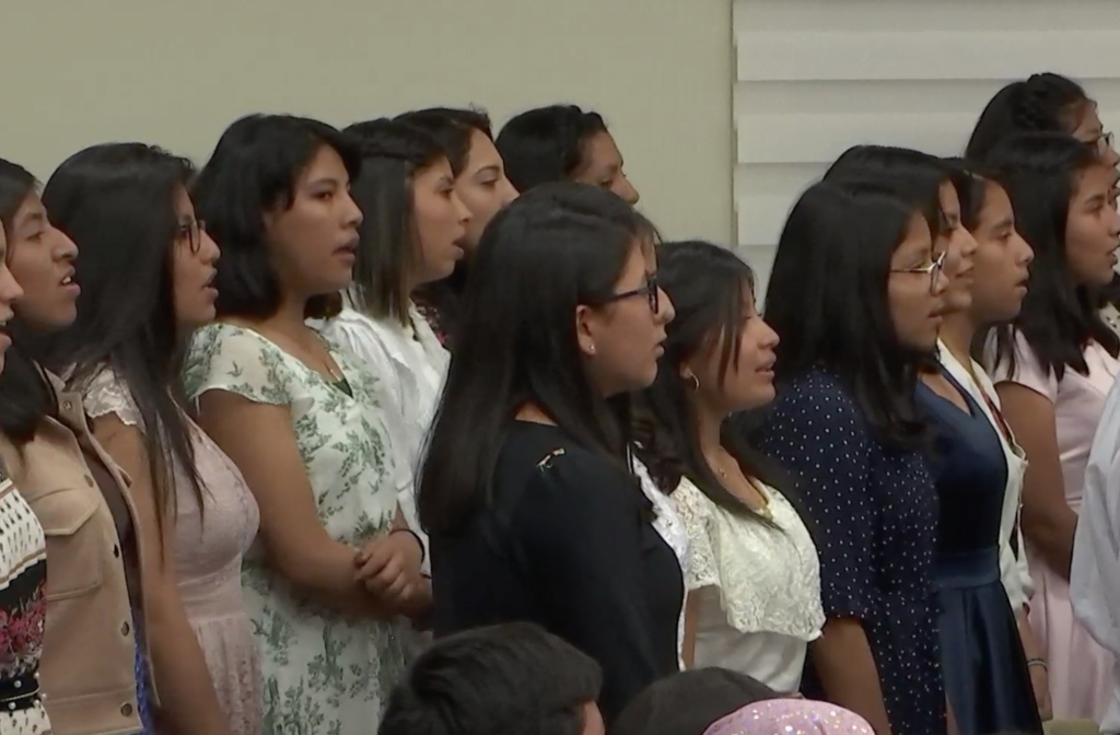 Young women sing in youth choir at a Dec. 14, 2019, youth devotional in Arequipa, Peru.