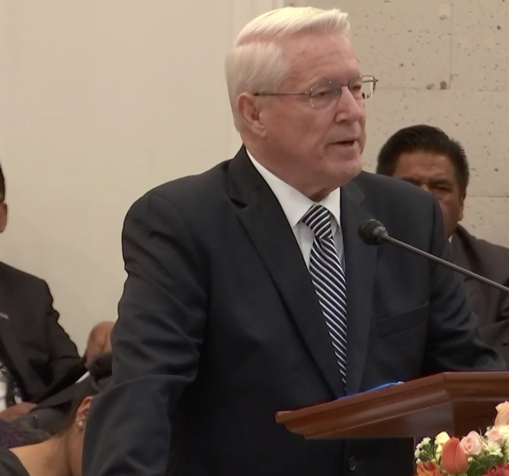 Bishop Dean M. Davies, first counselor in the Presiding Bishopric, counsels youth to embrace the gospel at Dec. 14, 2019, youth devotional in Arequipa, Peru.