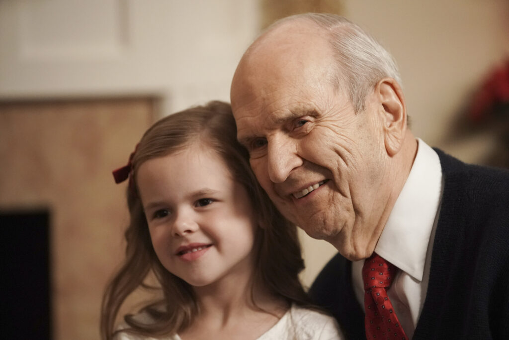 President Russell M. Nelson of The Church of Jesus Christ of Latter-day Saints hugs Claire Crosby in Salt Lake City on Dec 6, 2019.