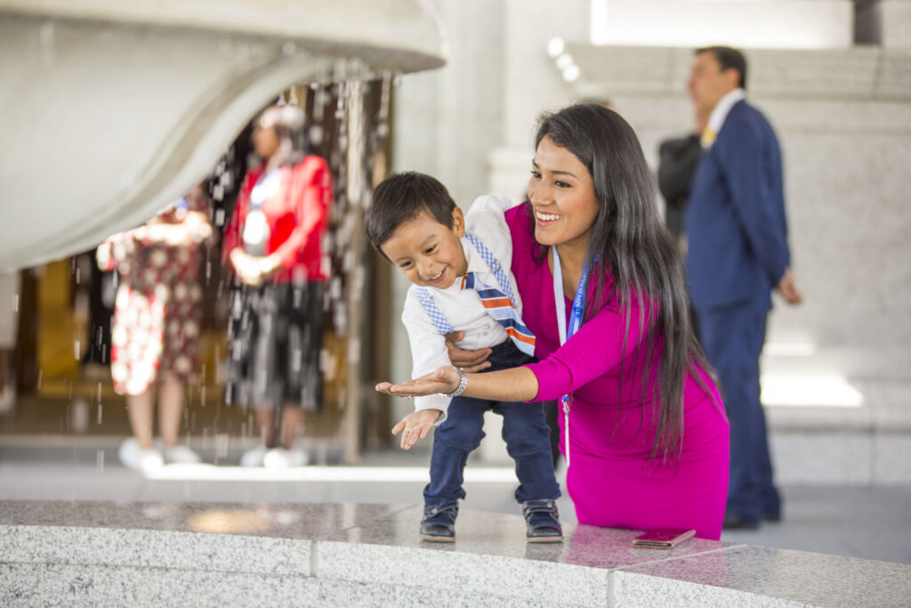 A young mother and her son enjoy the fountain outside the Arequipa Peru Temple on Dec. 15, 2019.