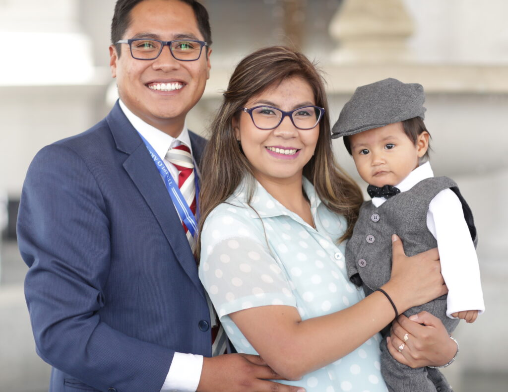 A young family enjoys being together during the dedication of the Arequipa Peru Temple on Dec. 15, 2019.