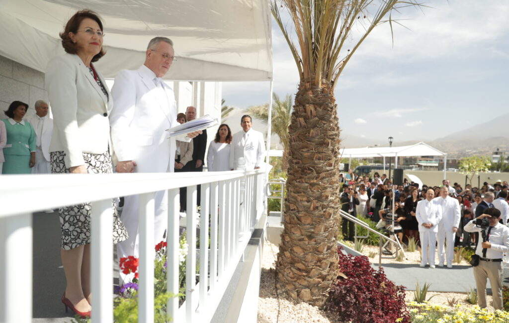Elder Ulisses Soares — with his wife, Sister Rosana Soares at his side — shares a few remarks at the cornerstone ceremony outside the Arequipa Peru Temple on Dec. 15, 2019.