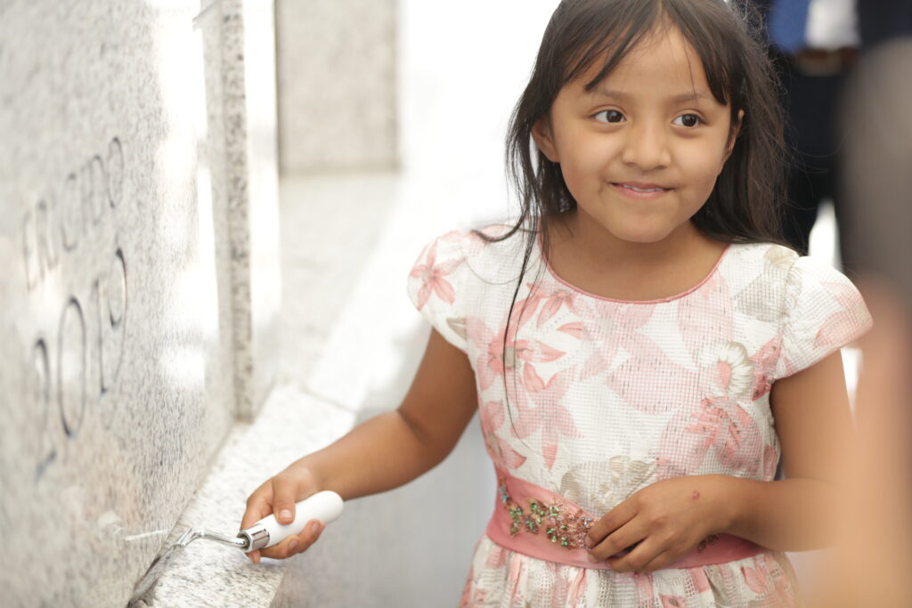 A little girl takes a turn placing mortar on the cornerstone of the Arequipa Peru Temple on Dec. 15, 2019.