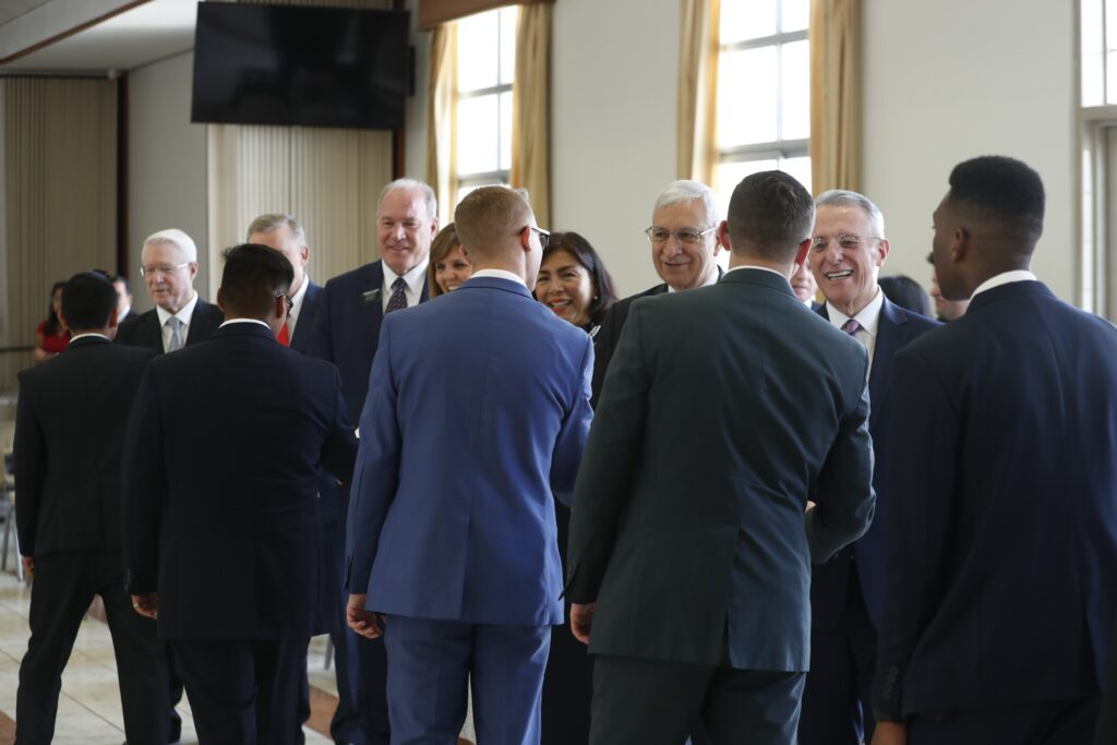 Elder Ulisses Soares greets missionaries of the Peru Arequipa Mission prior to a devotional on Saturday, Dec. 14, 2019.