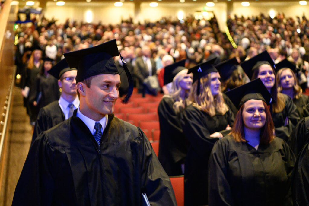 Graduates enter the BYU–Idaho Center on Wednesday, Dec. 18, 2019, for the fall commencement ceremony.