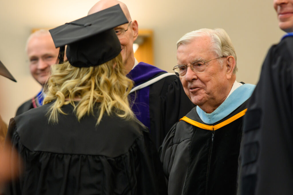 President M. Russell Ballard, Acting President of the Quorum of the Twelve Apostles, smiles as he greets a graduate following the convocation for the College of Education and Human Development: Sociology, Social Work and Psychology on Wednesday, Dec. 18, 2019.