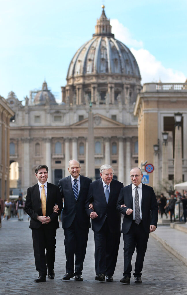 President Russell M. Nelson of The Church of Jesus Christ of Latter-day Saints and President M. Russell Ballard, acting president of the Quorum of the Twelve Apostles; Elder Massimo De Feo, General Authority Seventy, left; and Elder Alessandro Dini Ciacci, Area Seventy, right, walk near the Vatican in Rome, Italy, on Saturday, March 9, 2019, after meeting with Pope Francis.