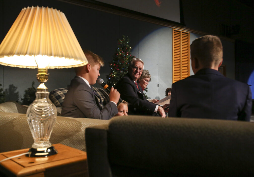 President David E. LeSueur, center, asks three of his grandchildren what their gift to the Lord will be this Christmas during the annual Christmas Eve Nativity Program at the Provo Missionary Training Center in Provo, Utah, on Tuesday, Dec. 24, 2019.