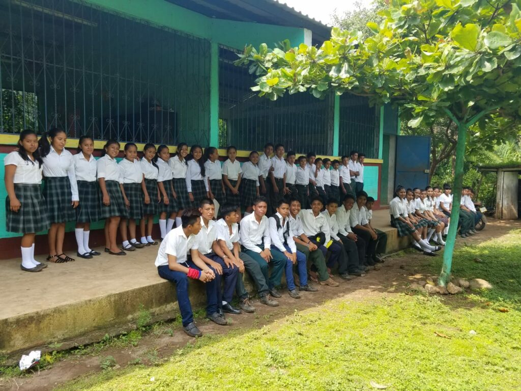 Students and teachers at one of the schools where the SOYLA Foundation sponsors scholarships in Guatemala pose for a group photo.