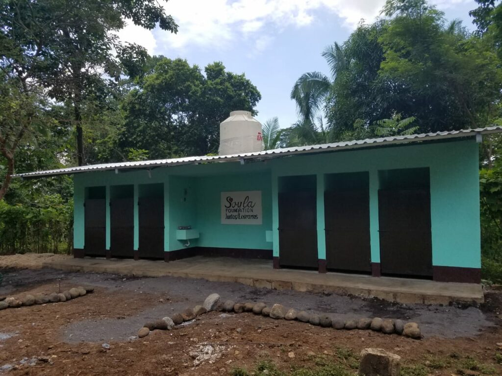 Newly built toilet facilities donated by the SOYLA Foundation at a school in Guatemala.