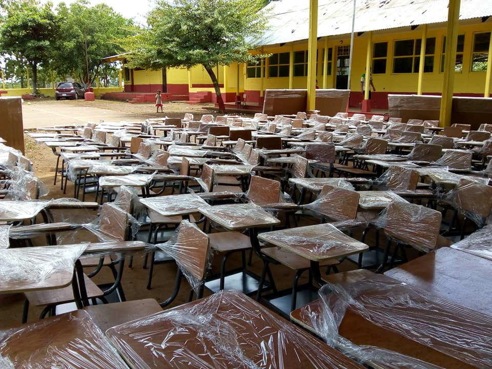 New desks, donated by the SOYLA Foundation, are delivered to a school in Guatemala.