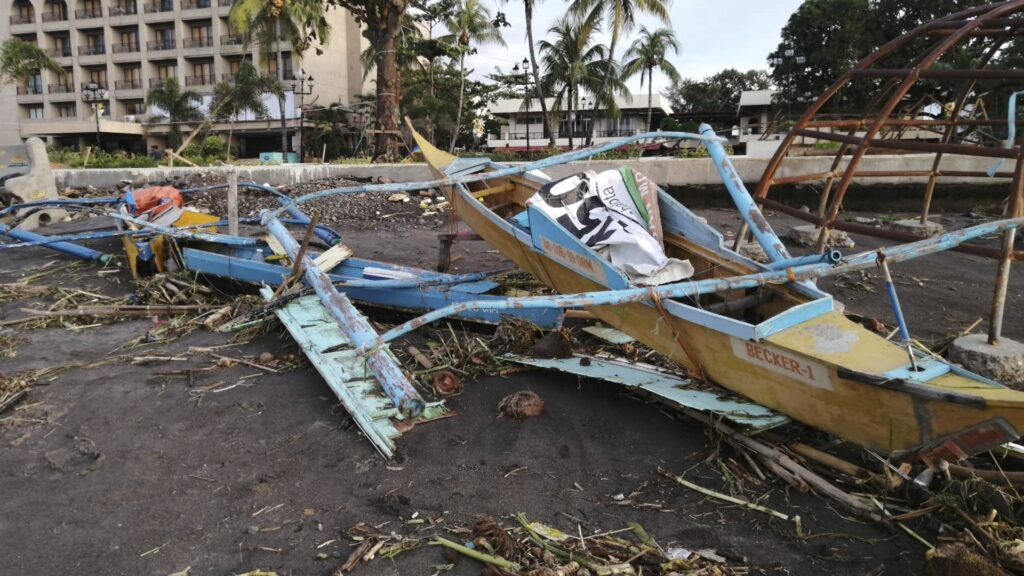 An outrigger boat destroyed by Typhoon Phanfone sits on the coastline Thursday, Dec. 26, 2019, in Ormoc City, central Philippines. The typhoon left over a dozen dead and many homeless.