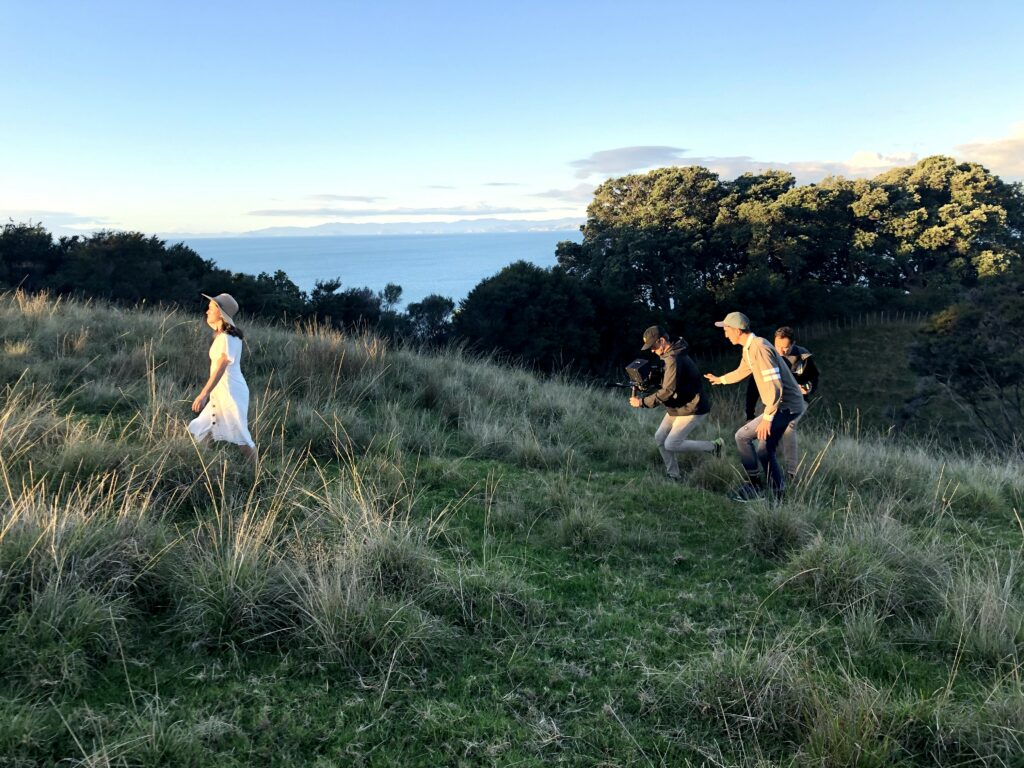 Film crew work on the new 2020 youth theme video with four youth from New Zealand.