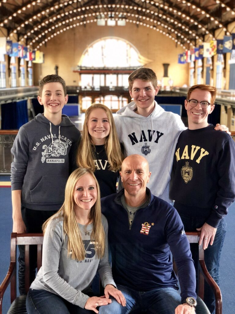 Kelly and Heather Laing with their children, from left, Mason, Ashley, Britton and Quincy, pose for picture at the U.S. Naval Academy in Annapolis, Maryland.