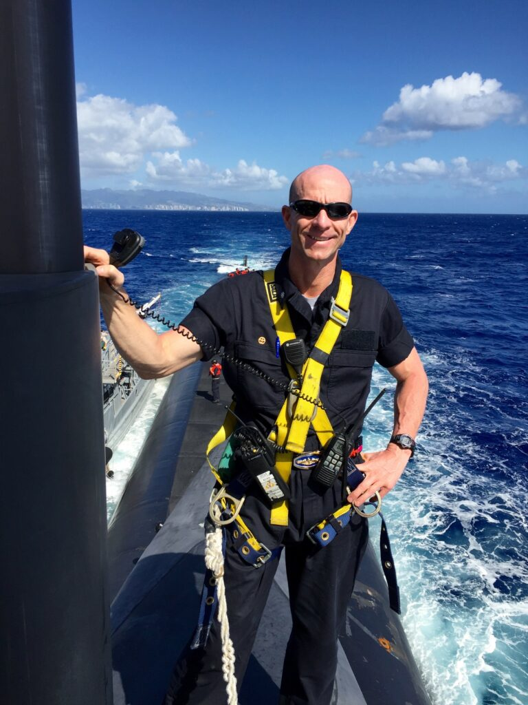 U.S. Navy Commander Kelly Laing stands atop an American submarine out at sea. The lifelong Latter-day Saint has spent more than six years serving underwater.