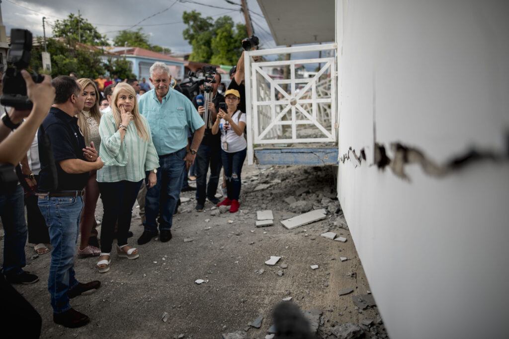 Governor Wanda Vazquez inspect an earthquake-damaged house in Guanica, Puerto Rico, Monday, Jan. 6, 2020. A 5.8-magnitude quake hit Puerto Rico before dawn Monday, unleashing small landslides, causing power outages and severely cracking some homes.