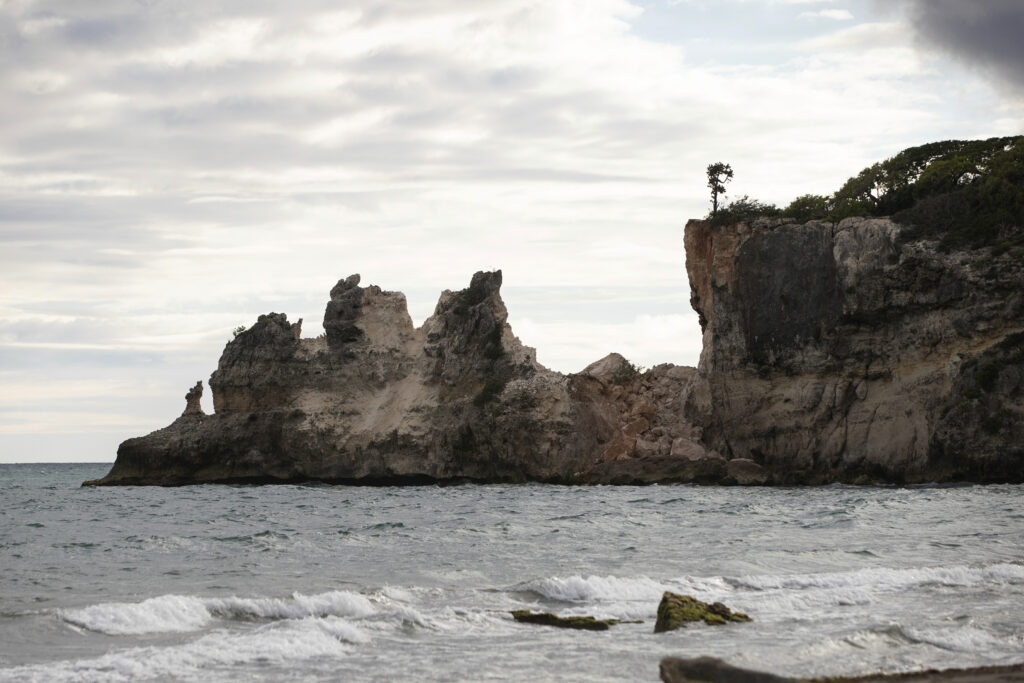 """A natural formation known as """"Punta Ventana,"""" or Window Point, stands without the bridge that once created the formation of the window, or a hole, in Guayanilla, Puerto Rico, Monday, Jan. 6, 2020. The natural bridge collapsed during the morning's earthquake."""