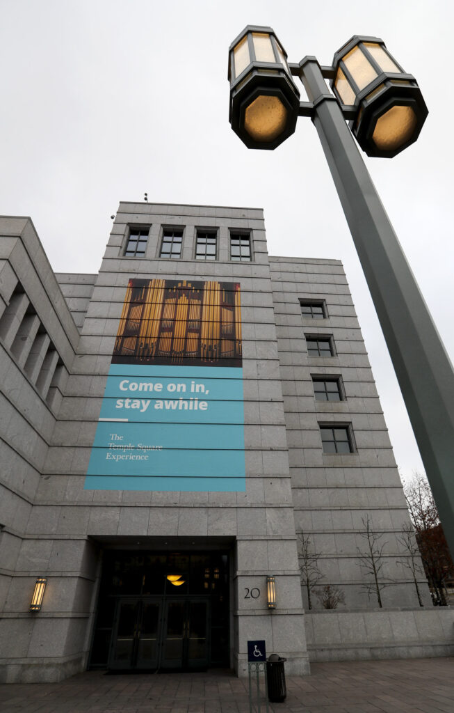 A sign on The Church of Jesus Christ of Latter-day Saints' Conference Center in Salt Lake City inviting guests to visit is pictured on Monday, Dec. 30, 2019.