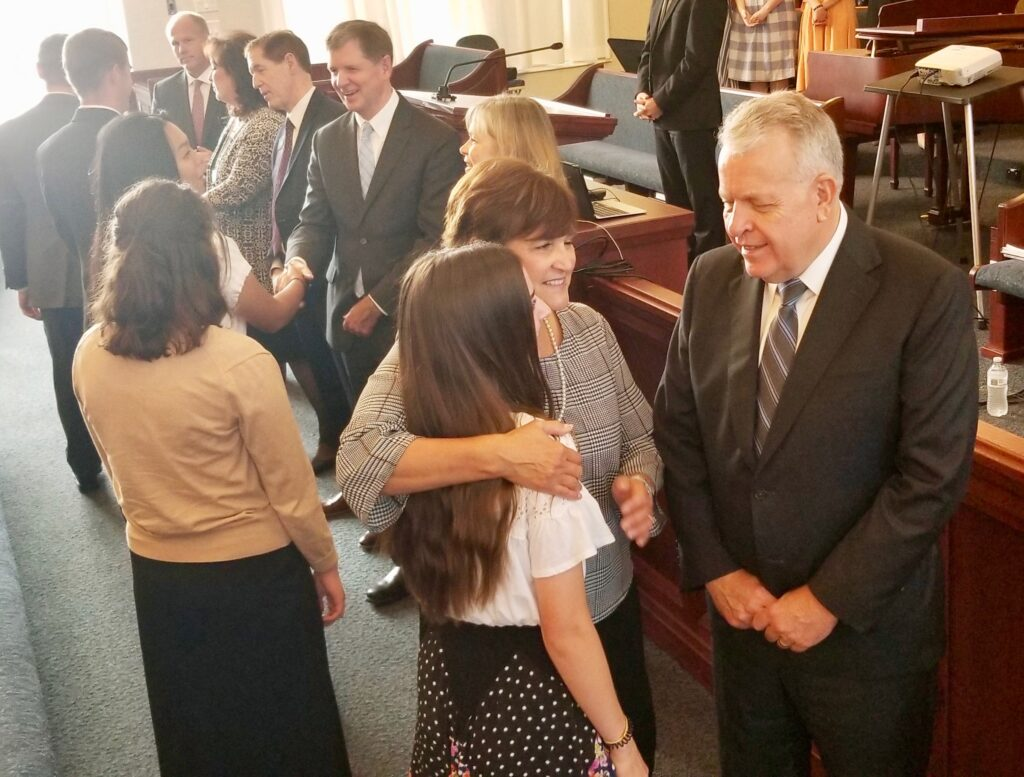 Elder Brent H. Nielson and Sister Marcia Nielson greet a sister missionary, as Sister Mary Rasband, Elder James R. Rasband, President Rhys A. Weaver and Sister Pamela Weaver welcome others at the start of a Tennessee Nashville Mission tour conference session on Sept. 19, 2019, in Brentwood, Tennessee.