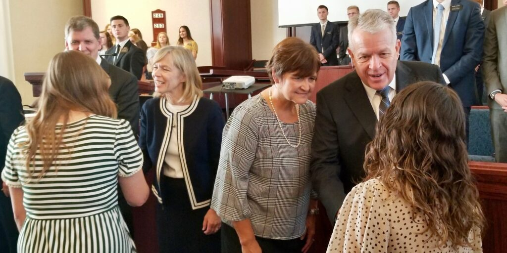 Elder Brent H. Nielson, right, and Sister Marcia Nielson greet a sister missionary, as do Elder James R. Rasband, left, and Sister Mary Rasband prior to a Tennessee Nashville Mission tour session on Sept. 19, 2019, in Brentwood, Tennessee.