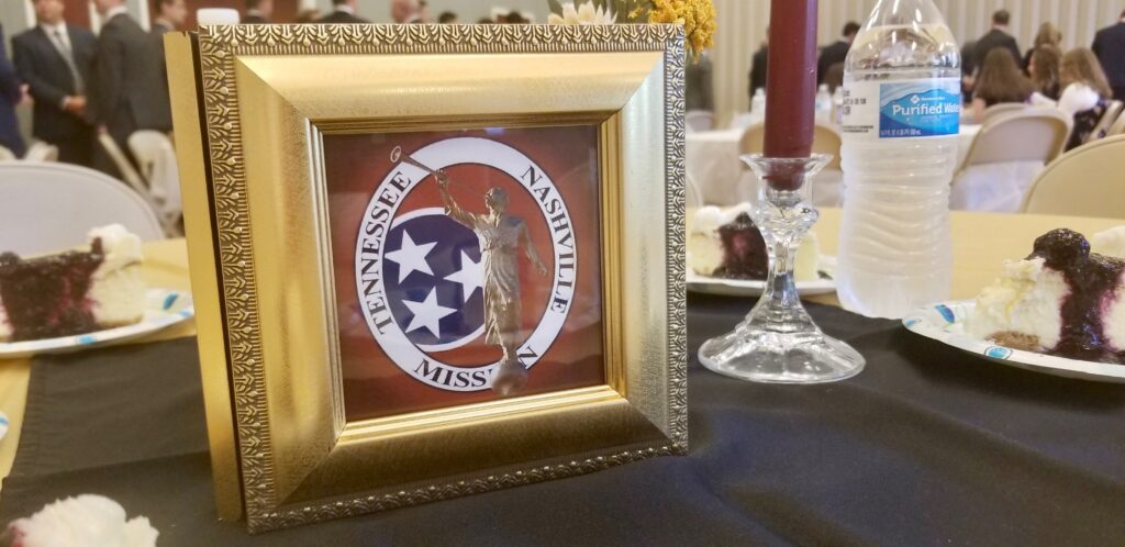 A framed logo of the Tennessee Nashville Mission is the featured centerpiece on a luncheon table between mission tour meetings in Brentwood, Tennessee, on Sept. 19, 2019.