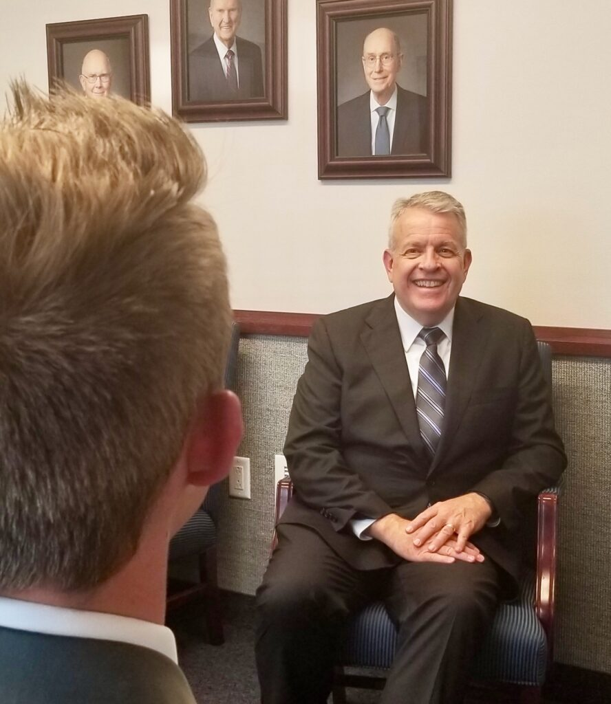 Elder Brent H. Nielson, a General Authority Seventy, interviews a missionary following a Tennessee Nashville Mission tour meeting on Sept. 19, 2019, in Brentwood, Tennessee.