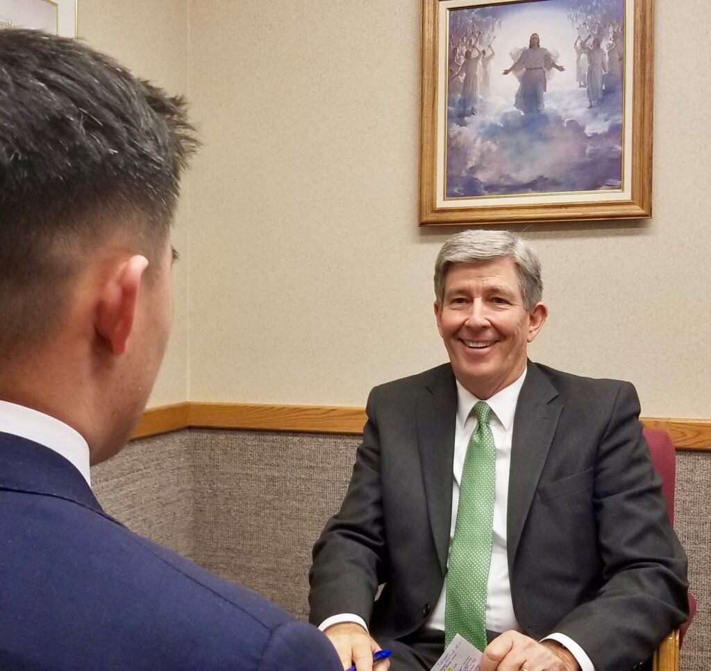 Elder S. Gifford Nielsen, an assistant executive director in the Missionary Department, interviews an elder following Canada Calgary Mission tour meetings on Oct. 31, 2019, in Calgary, Canada.