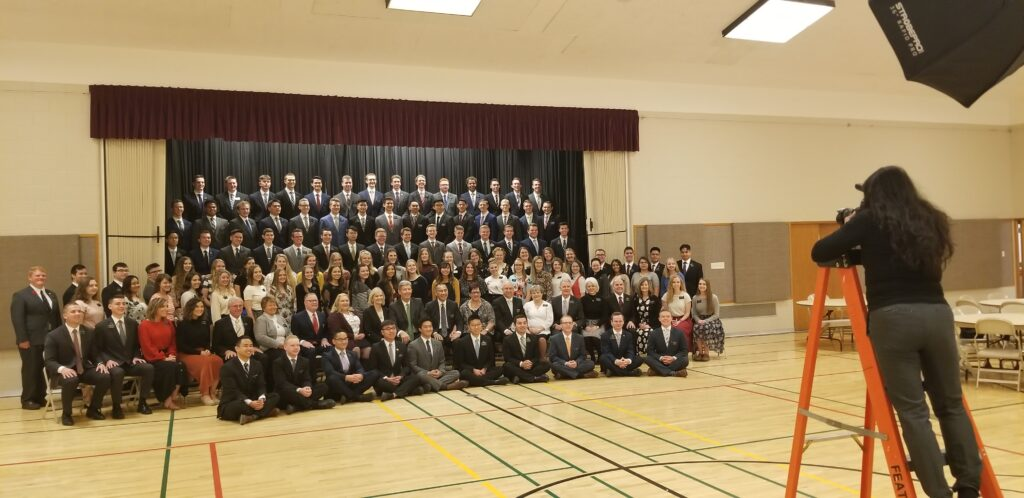 Elder S. Gifford Nielsen and Sister Wendy Nielsen join leadaers and missionaries of the Canada Calgary Mission for a group photo at the start of a mission tour meeting on Oct. 31, 2019, in Calgary, Canada.